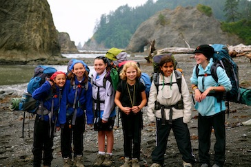 Girls age 11 backpacking at summer camp in wWashington