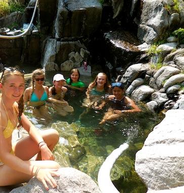 Teen girls group soaking at hot springs