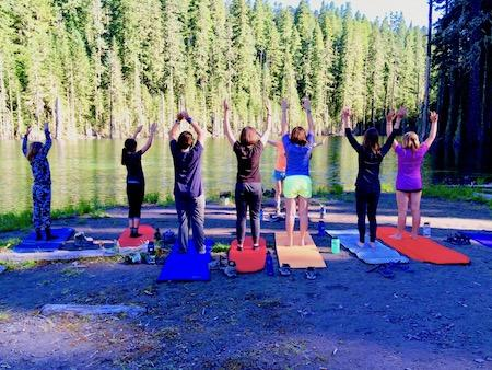 Girl's summer camp with yoga by the river