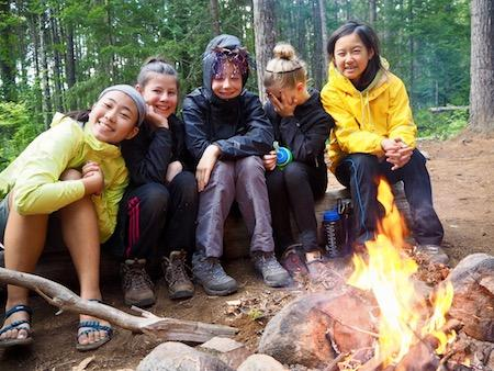 Girls camping in tent