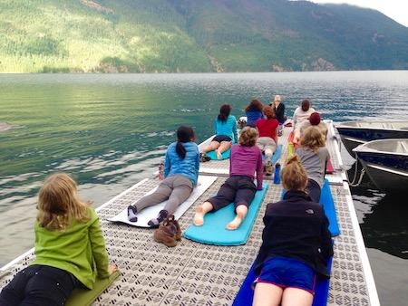 Girl's summer camp with yoga on the dock