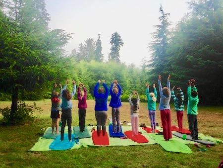 Girl's summer camp with yoga stretch