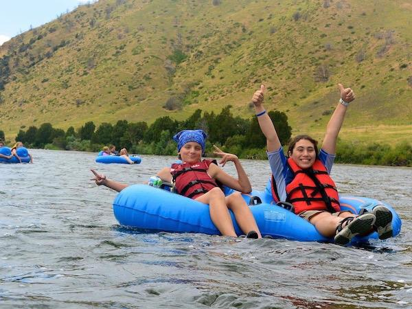Float a river in tubes at summer camp MT