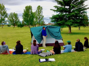 Camp guides learning tent skills summer camp